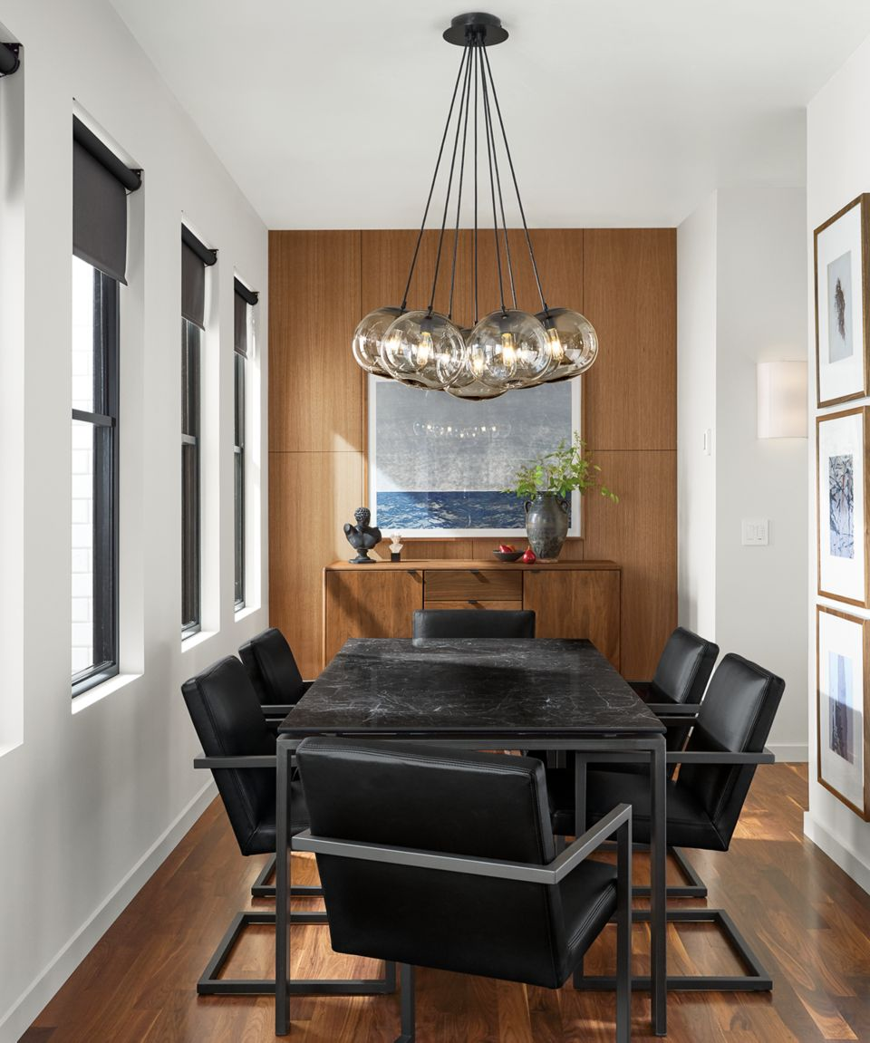 Detail of Rand dining table in dining room with natural steel base and black marbled top