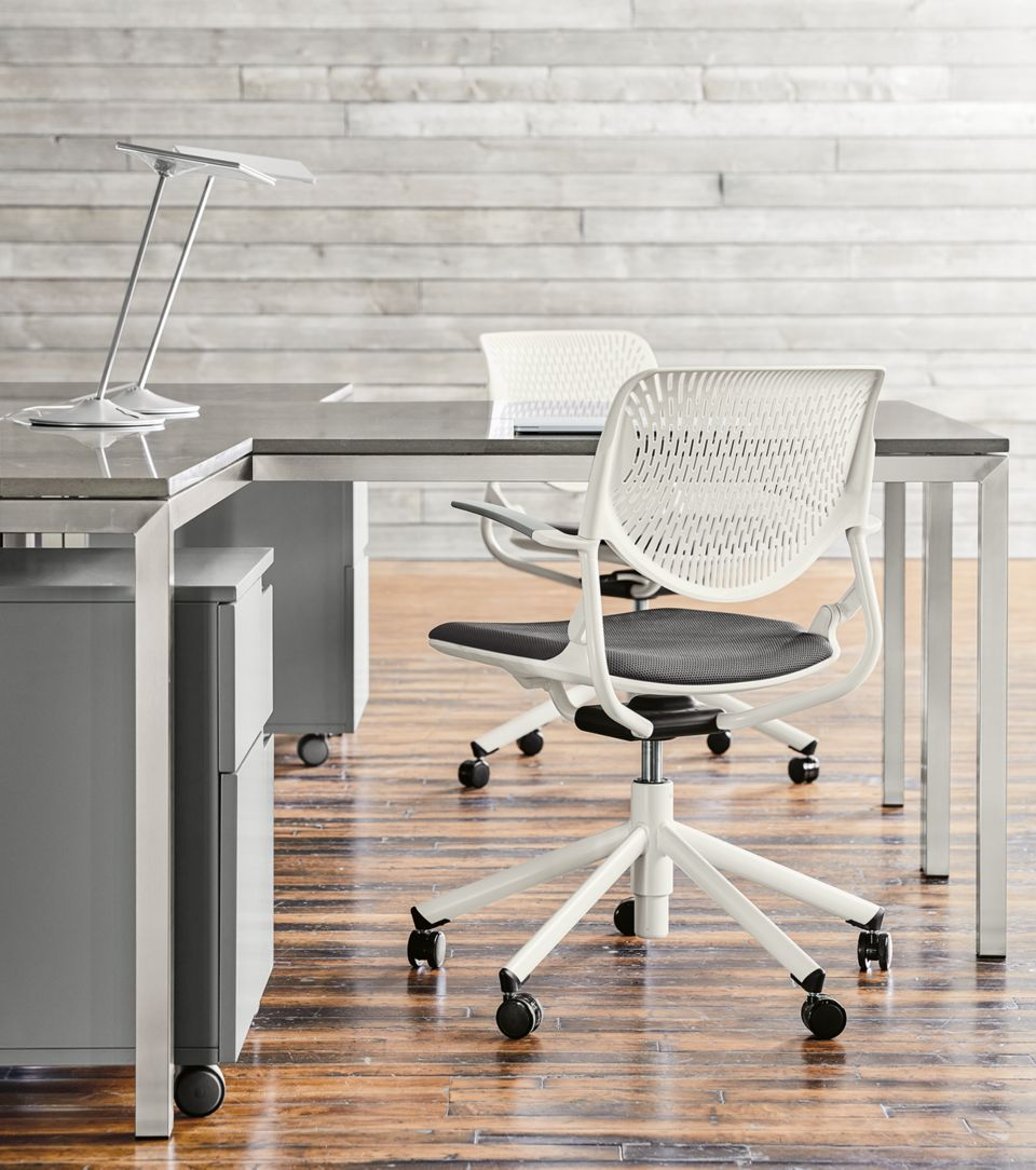 Detail of Runa swivel office chairs in white with grey seat