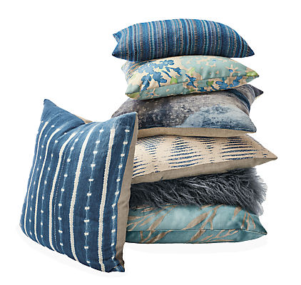Detail of stack of throw pillows (7) in shades of blue