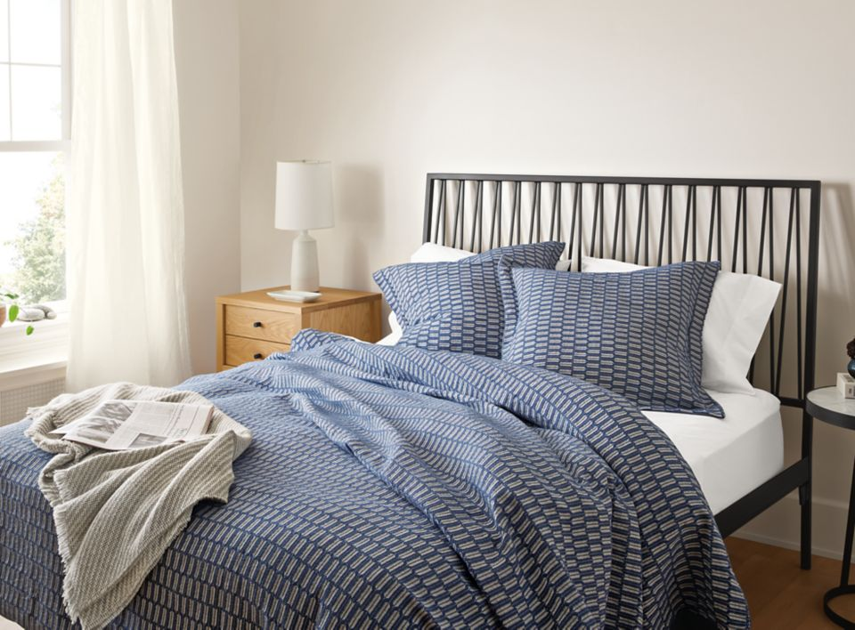 Detail of Sheffield bedding in blue on Jennings bed