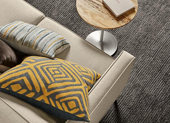 Detail of Shepton throw pillow in saffron fabric