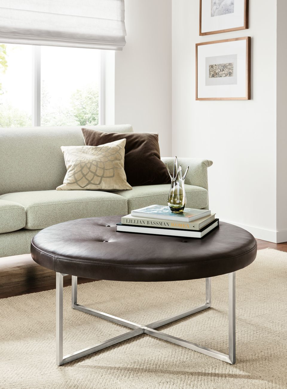 Detail of Sidney round ottoman with leather top and stainless steel base
