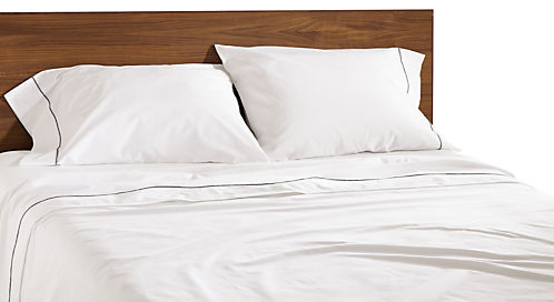 Detail of Sommerville percale queen sheet set in white with charcoal stitching and Copenhagen queen bed