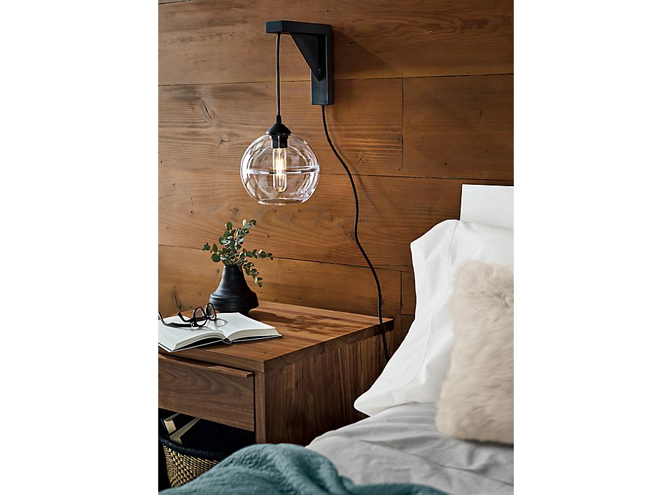 Detail of Tandem wall sconce in natural steel in bedroom