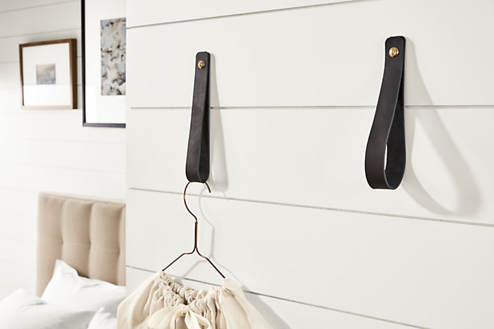 Detail of two Thorton leather wall hooks in black leather