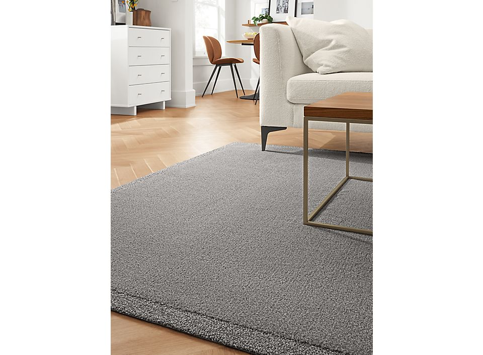 Detail of Tidal border rug in grey