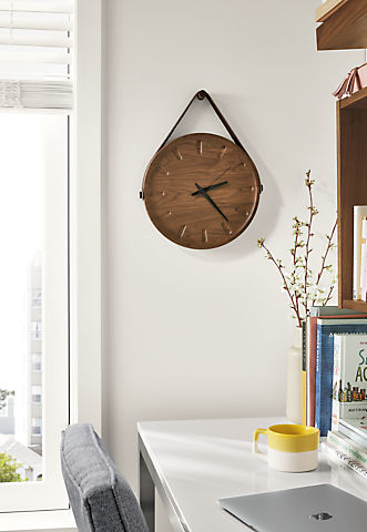 Detail of Toland wall clock in walnut above desk