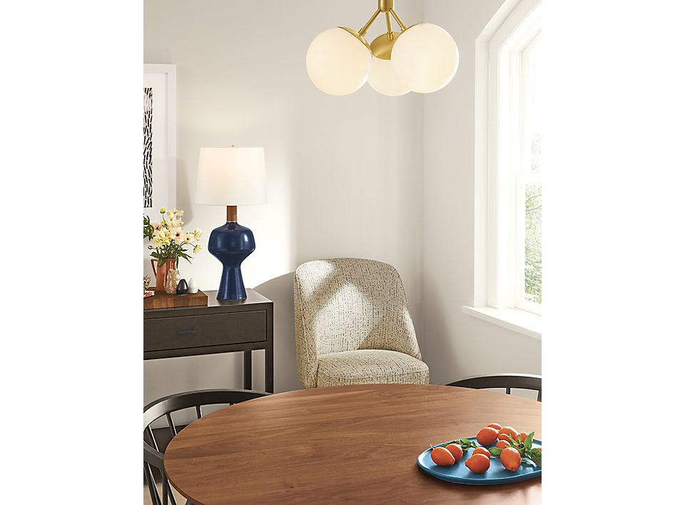 Detail of Triton flushmount ceiling light in brass finish above table