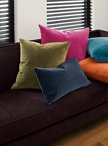 Detail of Velvet throw pillow in magenta