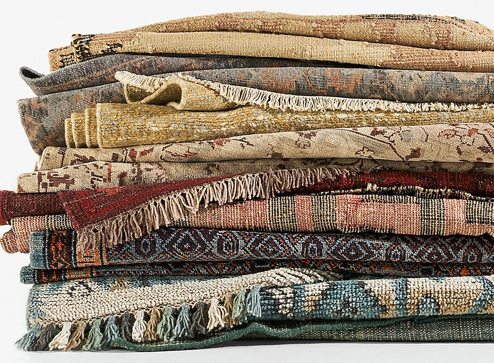 Detail of colorful wool rugs folded and stacked