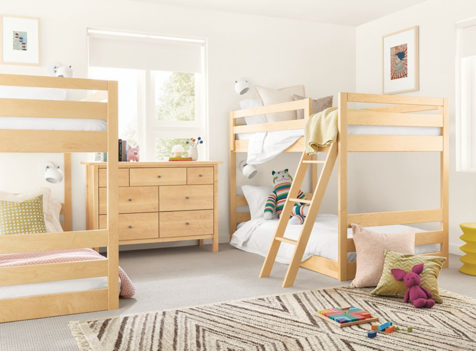 Detail of two Waverly mini bunk beds both in maple