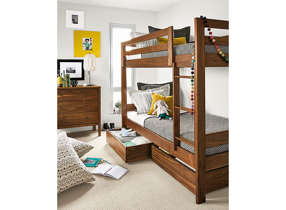 Detail of Waverly twin bunk in walnut in kids' bedroom with left trundle open