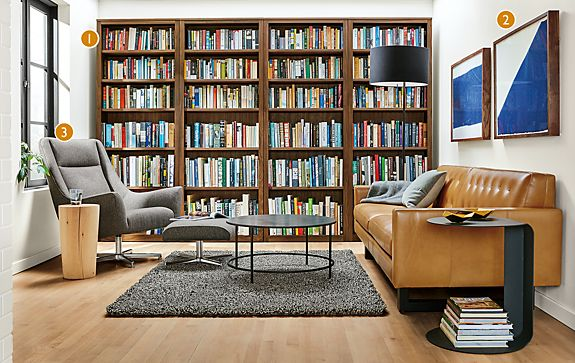 Share This Room: - Wells Leather Sofa With Woodwind Walnut Bookcases - Modern Living