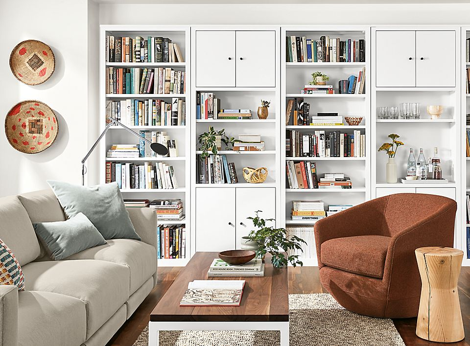 Detail of Woodwind bookcases in white in living room with Gibbs chair and Clemens sofa