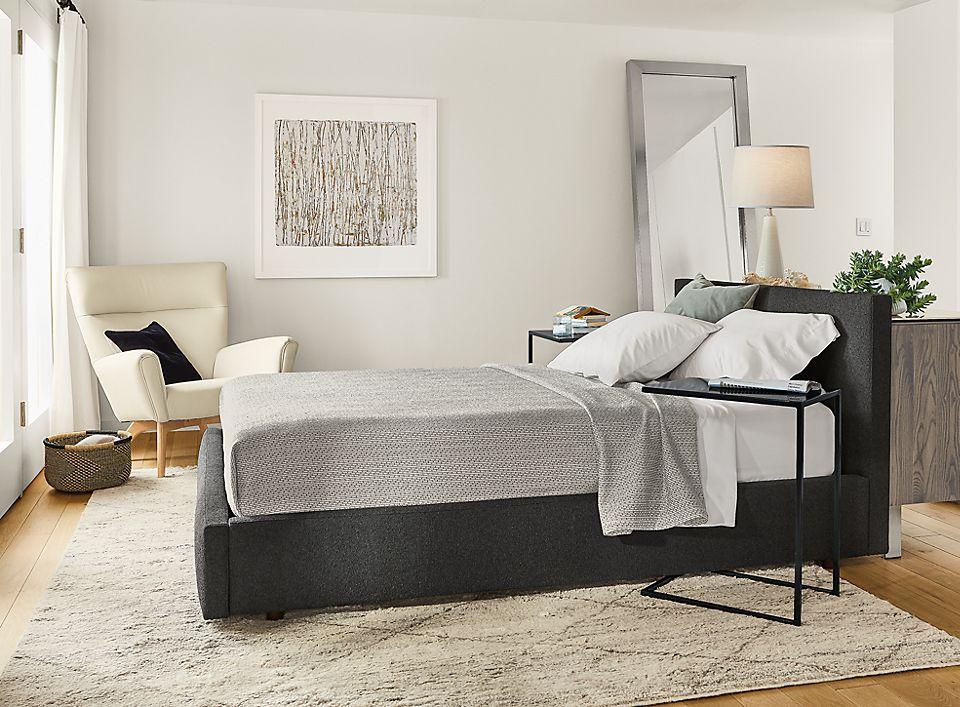Detail of Wyatt queen storage bed in Declan Graphite fabric in small bedroom
